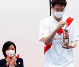La flamme olympique est arrivée à Tokyo sans public, le 9 juillet 2021. © Kim Kyung-hoon, AFP